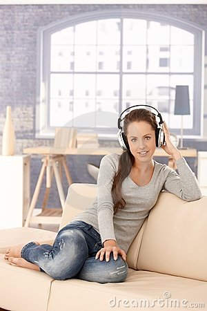 Young woman enjoying music through headphones