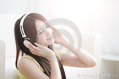 Young woman enjoying the music at home