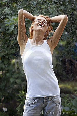 Young Woman Enjoying Rain