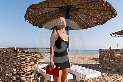 Young woman enjoying sunny weather