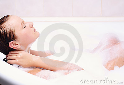 Young woman enjoys the bath-foam