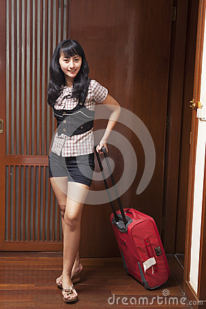Young woman entering a hotel room