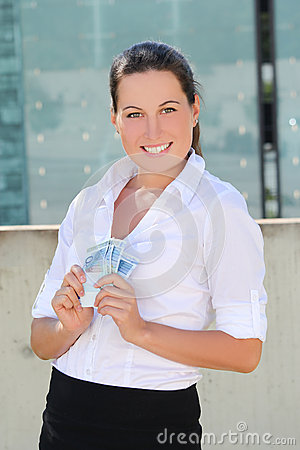 Young woman with  euro banknotes in the street