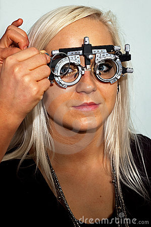 Young woman examining the eyesight