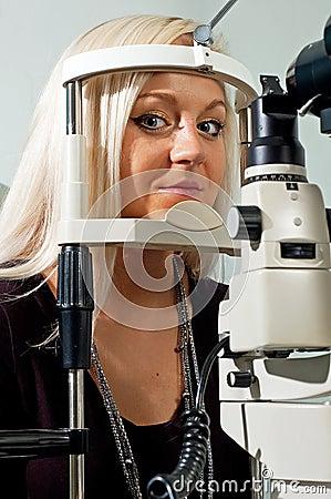 Young woman examining the eyesight