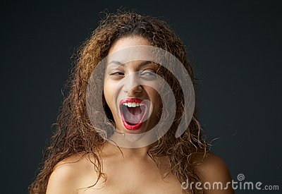 Young woman excited and laughing with open mouth