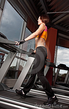 Young woman exercise on treadmill