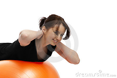 Young woman exercising with exercise ball