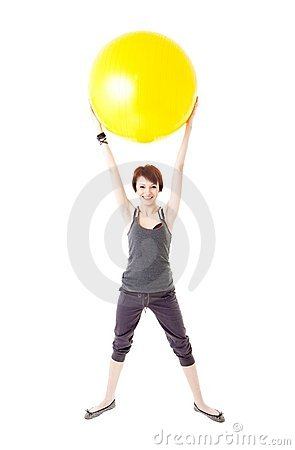 Young woman exercising on a fitness ball