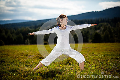 Young woman exercising yoga outdoor