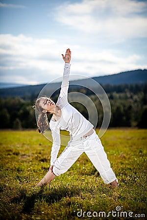 Young woman exercising yoga outdoor