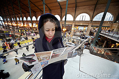 Young woman explores map of Paris Editorial Stock Photo