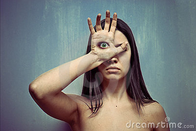 Young woman with eye on a palm