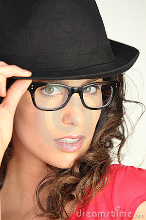 Young woman with eyeglasses and black hat