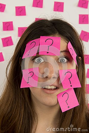 Young woman face covered in question mark stickies