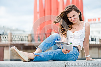 Young woman with fashion magazine