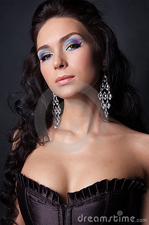 Young woman with fashion make-up and manicure