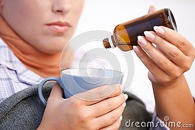 Young woman feeling bad taking vitamin