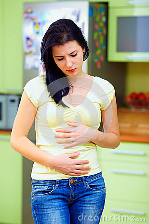 Young woman feels sick, home interior