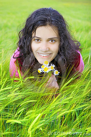 Young woman in field of wheat