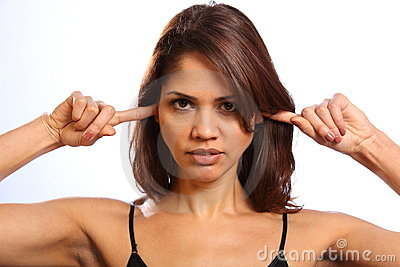Young woman fingers in ears not listening