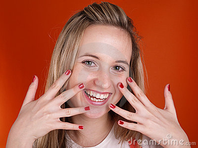 Young woman with fingers over her face
