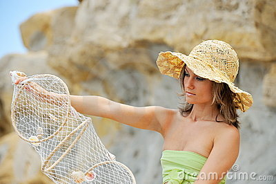 Young woman with fishing net