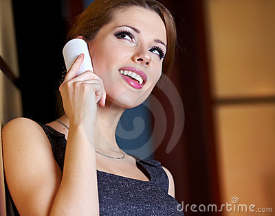 A young woman flirting  on the phone