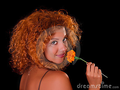 Young woman with flower on black