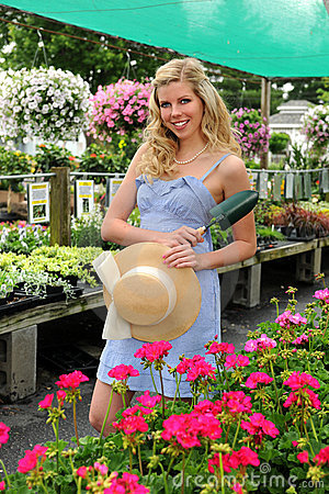 Young Woman in Flower Nursery