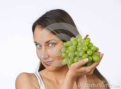 Young woman and fresh grapes