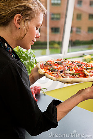 Young Woman with Fresh Pizza