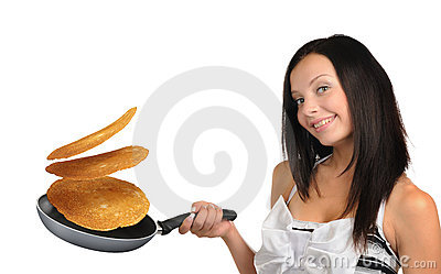 Young woman with a frying pan and pancakes