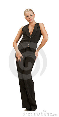 Young woman in a full-length trouser suit posing