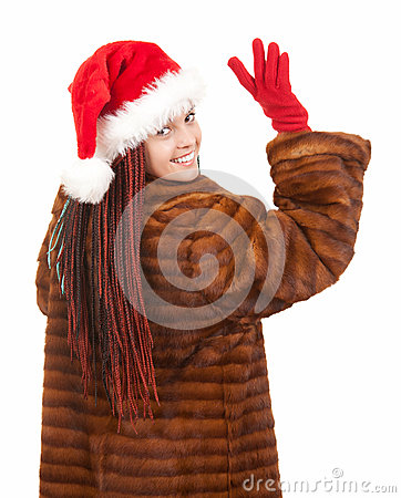 Young woman in fur and christmas hat waving hello