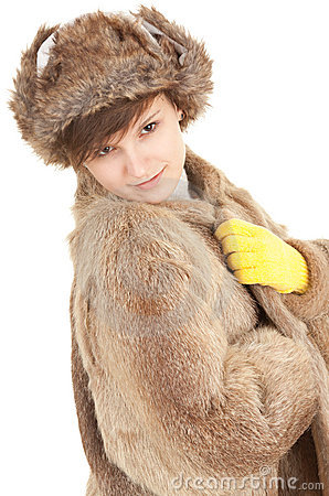 Young woman in a fur coat and hat