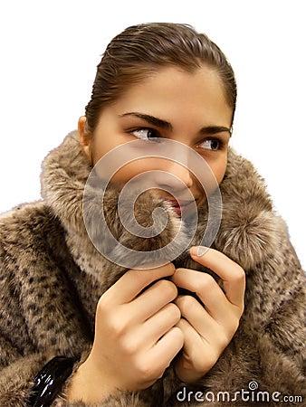 Young beautiful woman in fur coat