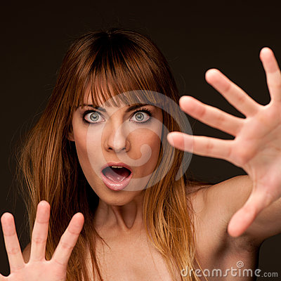 Young woman gesturing fear