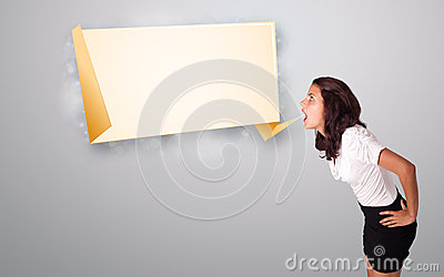 Young woman gesturing with origami copy space