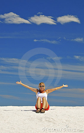 Young Woman Gesturing On Sand Dunes