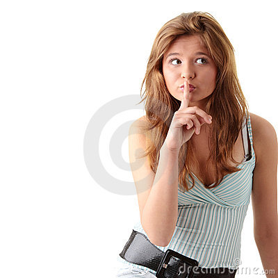 Young woman gesturing silence