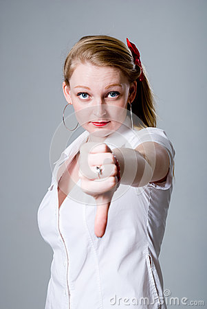 Young woman gesturing thumb down
