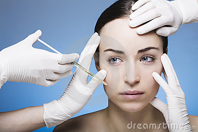 Young woman gets a botox injection