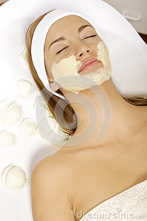 Young woman getting beauty skin mask treatment