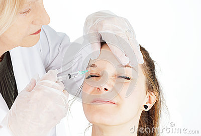 Young woman getting botox in her frown
