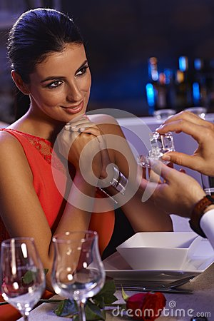 Young woman getting engagement ring
