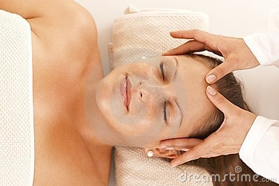 Young woman getting head massage