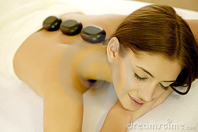 Young woman getting a hot stone massage