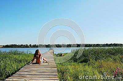 Young  woman getting a suntan