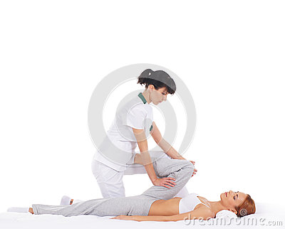 A young woman getting a traditional Thai massage